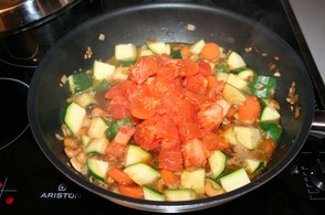 Add diced tomatoes to wok