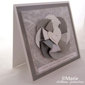 Silver themed wedding card with easy folded flower design
