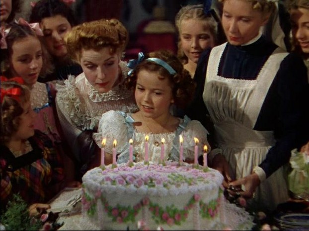 """Screenshot from a public domain film The Little Princess (1939) starring Shirley Temple and Richard Greene."""