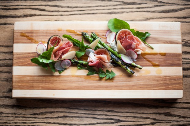 Spring salad, charred asparagus, ricotta, prosciutto, ramps, dandelion greens, figs.
