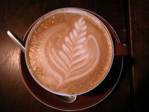 Cappuccino with fern motif.
