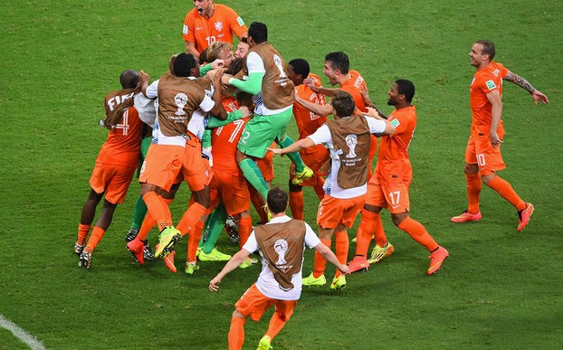 Tim Krul is mobbed by his Dutch team mates after saving the crucial penalty in the quarter finals