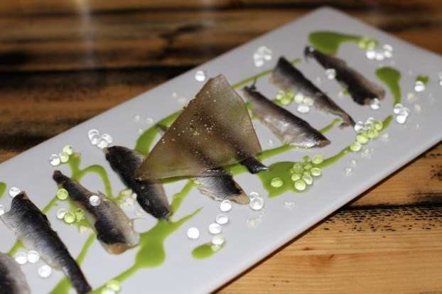 Marinated local white anchovies, sweet summer pea puree, olive oil powder, seawater caviar and a basil and black pepper