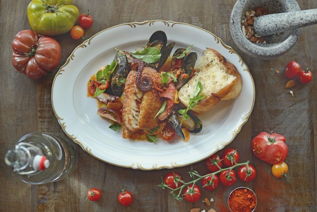 Spanish Picnic - A share platter with cod, octopus, mussels, romesco sauce, tomato salad and focaccia.