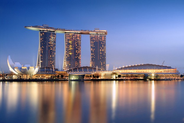 "Singapore (Malay: Pulau Ujong, ""island at the end"") lies off southern tip of Malay Peninsula."