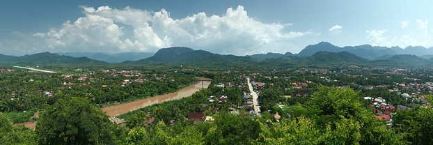 Panorama of Luang Prabang, north Laos, seen from Phu Si Hill: Nam Khan River to left; further left is Luang Prabang's airstrip.
