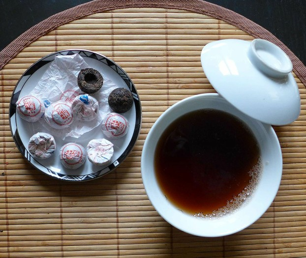 miniature tuocha-shaped pu'er tea cakes with tea infusion