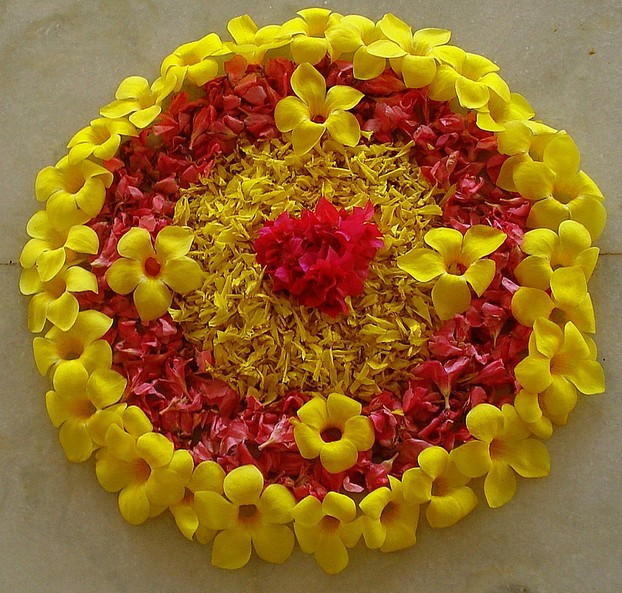 A simple Onam pookkalam made of fresh flowers