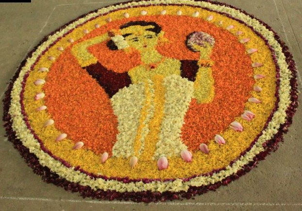 Floral design of a young lady in pookkalam