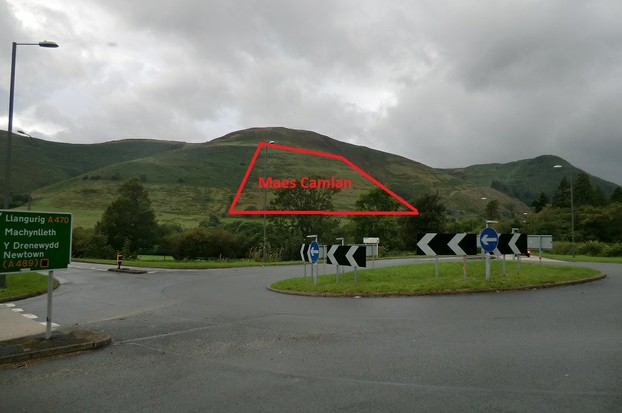Image: Maes Camlan, as viewed from the roadside before The Brigands Inn