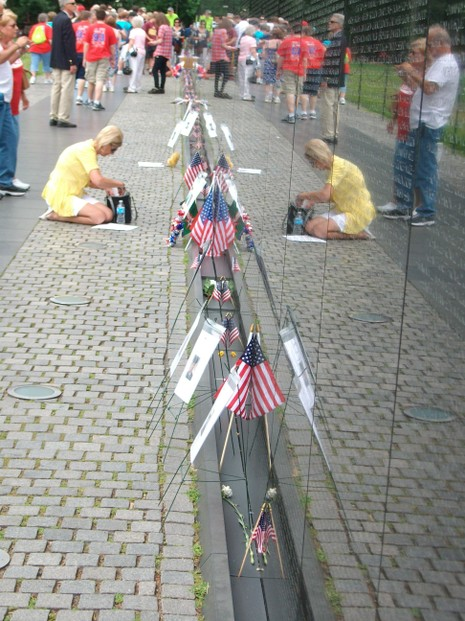 Leaving Tributes at the Vietnam Veterans Memorial Wall