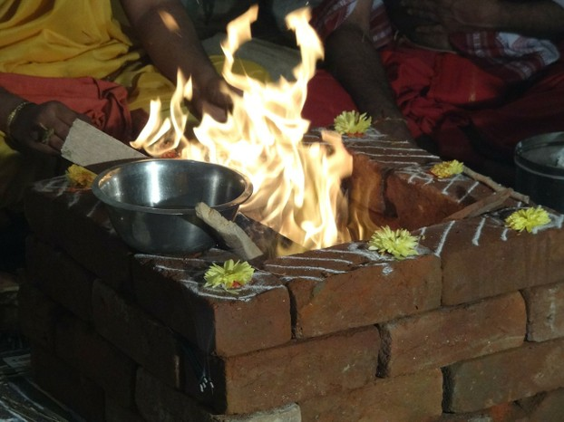 Hindu Preists Offering Ghee To The Fire Altar In A Ceremony