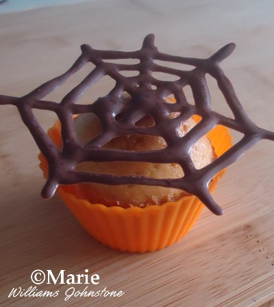 Chocolate spider web cobweb topper for cupcakes