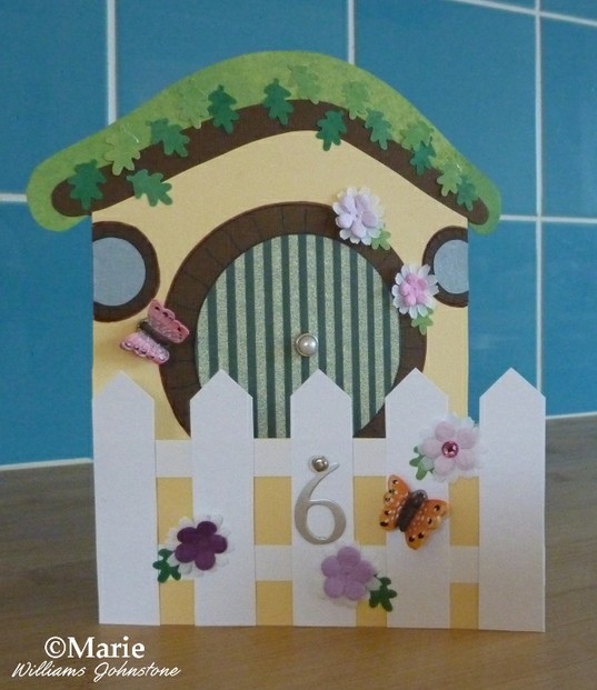 Hobbit themed house card with opening gate section and round door