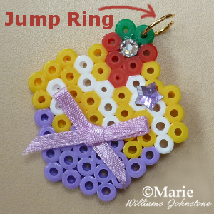 Adding an open jump ring to perler bead design to make jewelry