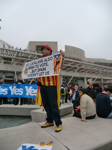 Image: Catalan Independence campaigner on camera before the Scottish Parliament Building