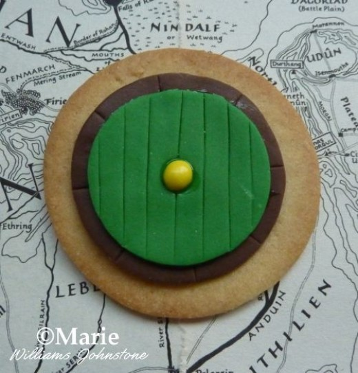 Make some Bag End style cookie biscuits by using round cookies decorated with fondant icing.