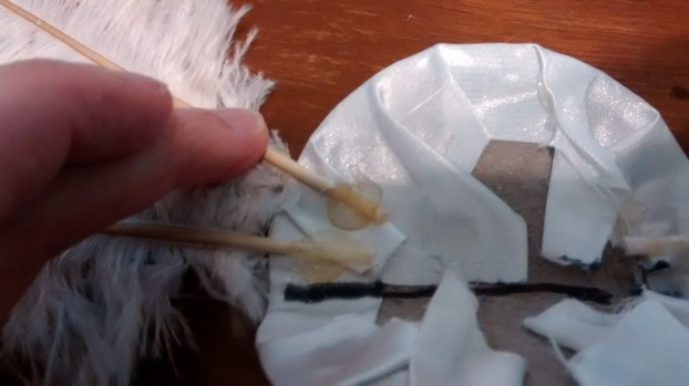 Glue feathers to base.