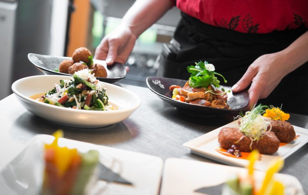 Selection of small plates – Warm swiss chard with preserved lemon, braised octopus salad, arancini & rabbit croquettes