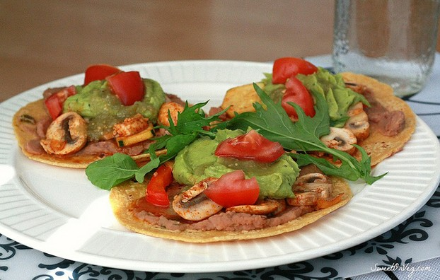 Veggie tacos with mushrooms, beans and guacamole