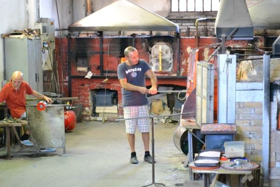 Artisans hard at work in a glass furnace on Murano - but not where we finally found our chandelier...