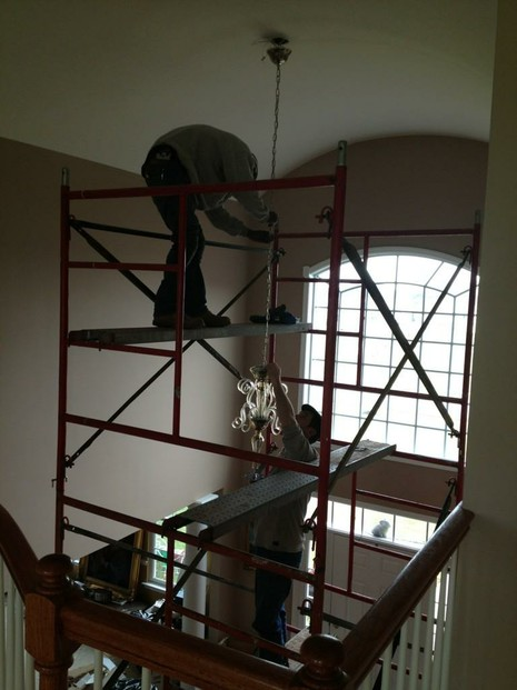 Our careful contractors on the scaffolding, installing our chandelier