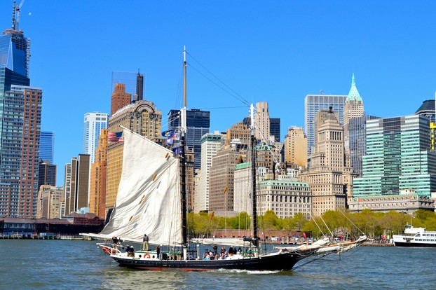 No, you don't get to ride a sailboat on the Circle Line. But you very likely may pass a couple as you cruise along...