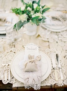 Ornate lace place setting with burlap wedding favor