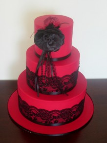 Red wedding cake with black lace