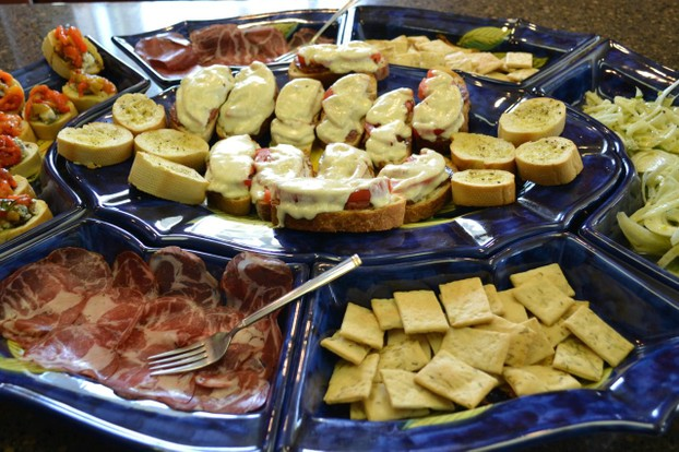 Plate of crostini and marinated salads