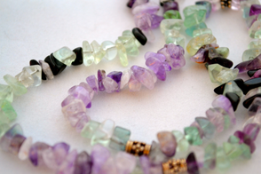 Light-colored fluorite chips make a pretty necklace with onyx and sterling silver.