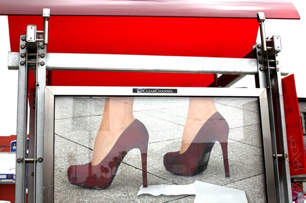 red high heels and toilet paper : muni awning, mission district, san francisco (2012)