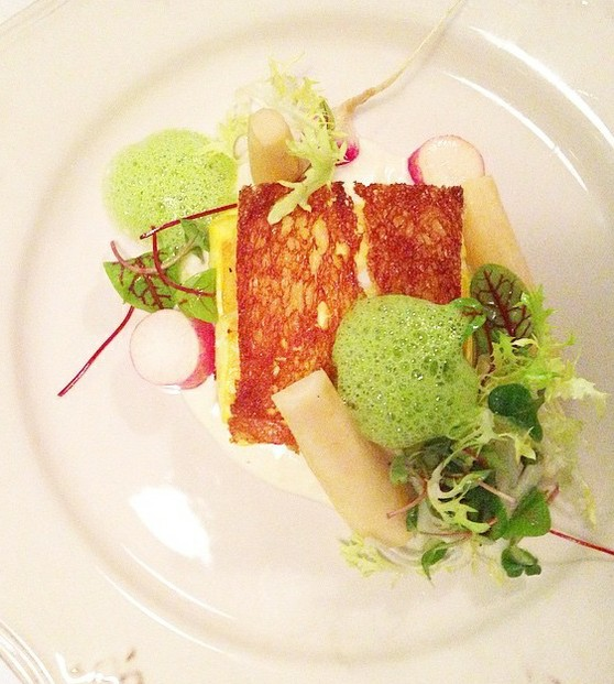 Saffron-poached halibut en croute: Pommes purée, citrus-braised parsley root, radish, watercress emulsion