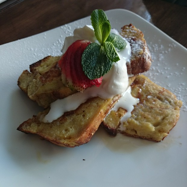Thick-sliced bread pudding French toast with bourbon maple syrup