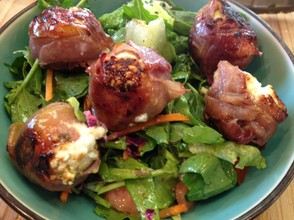Prosciutto-wrapped figs with goat cheese.