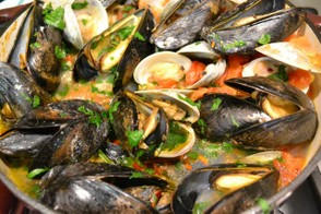 Clams and mussels in a white wine broth.
