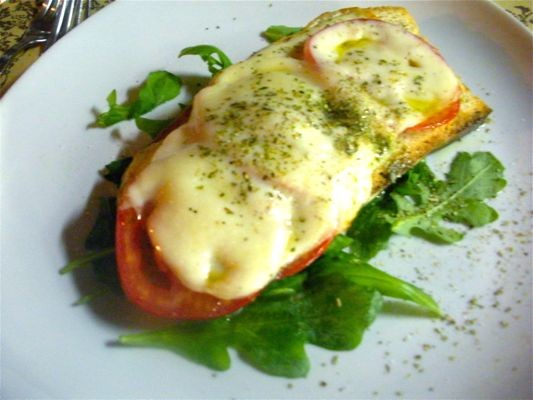 Tuscan-style Crostini with Tomato, Arugula and Mozzarella as served in Florence, Italy.