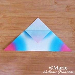 Folding the half triangle of paper