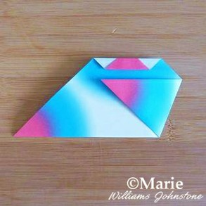 Folding side triangle over