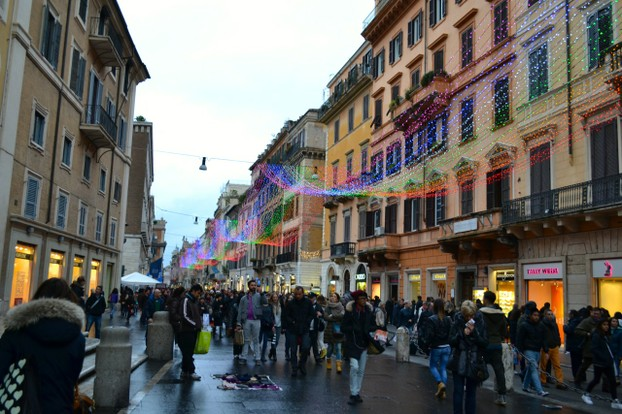 Colorful lights decorate many of the major pedestrian streets of Rome at Christmas.