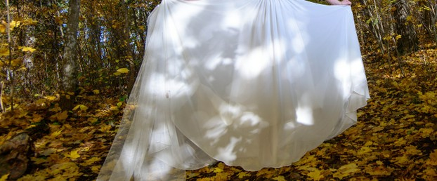 White Bridal Gown on Fall Leaves