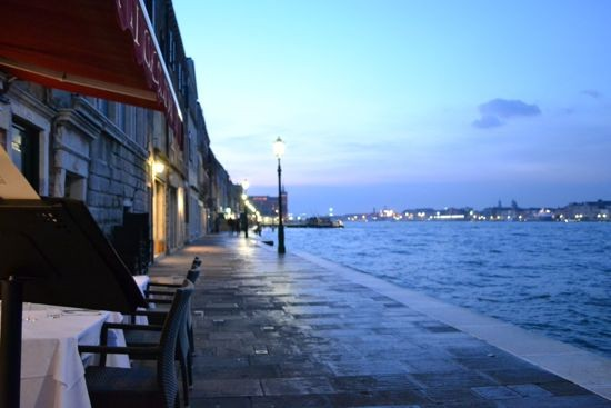 Travel to the Giudecca, where one can enjoy the best views of Venice and a lovely evening meal as the sun sets
