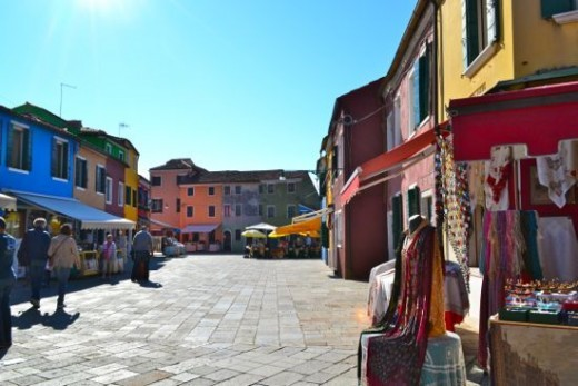 Ride to colorful Burano, where lace makers sell their wares and excellent seafood can be enjoyed