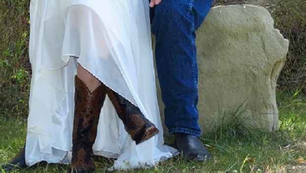 Cowboy and Cowgirl Bride and Groom Show Off Their Boots