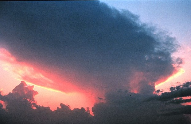 Thunderstorm anvil at sunset