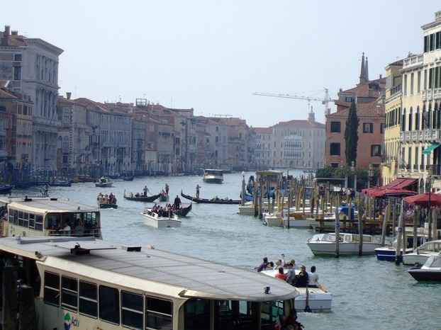 Gondolas, motor boats and vaporetto water buses crowding the Grand Canal