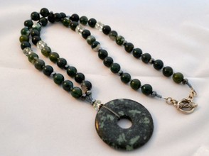 Moss agate used with a tree agate pendant disc