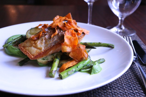 Pan Seared Salmon plated atop Pea & Mint Puree with Fingerling Potatoes, Asparagus & Crispy Carrots