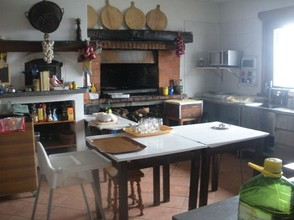The rustic kitchen of the restaurant - typical rural Italy.