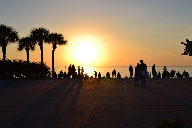 People gather in one spot at Pass-a-Grille beach for perfect sunset views.